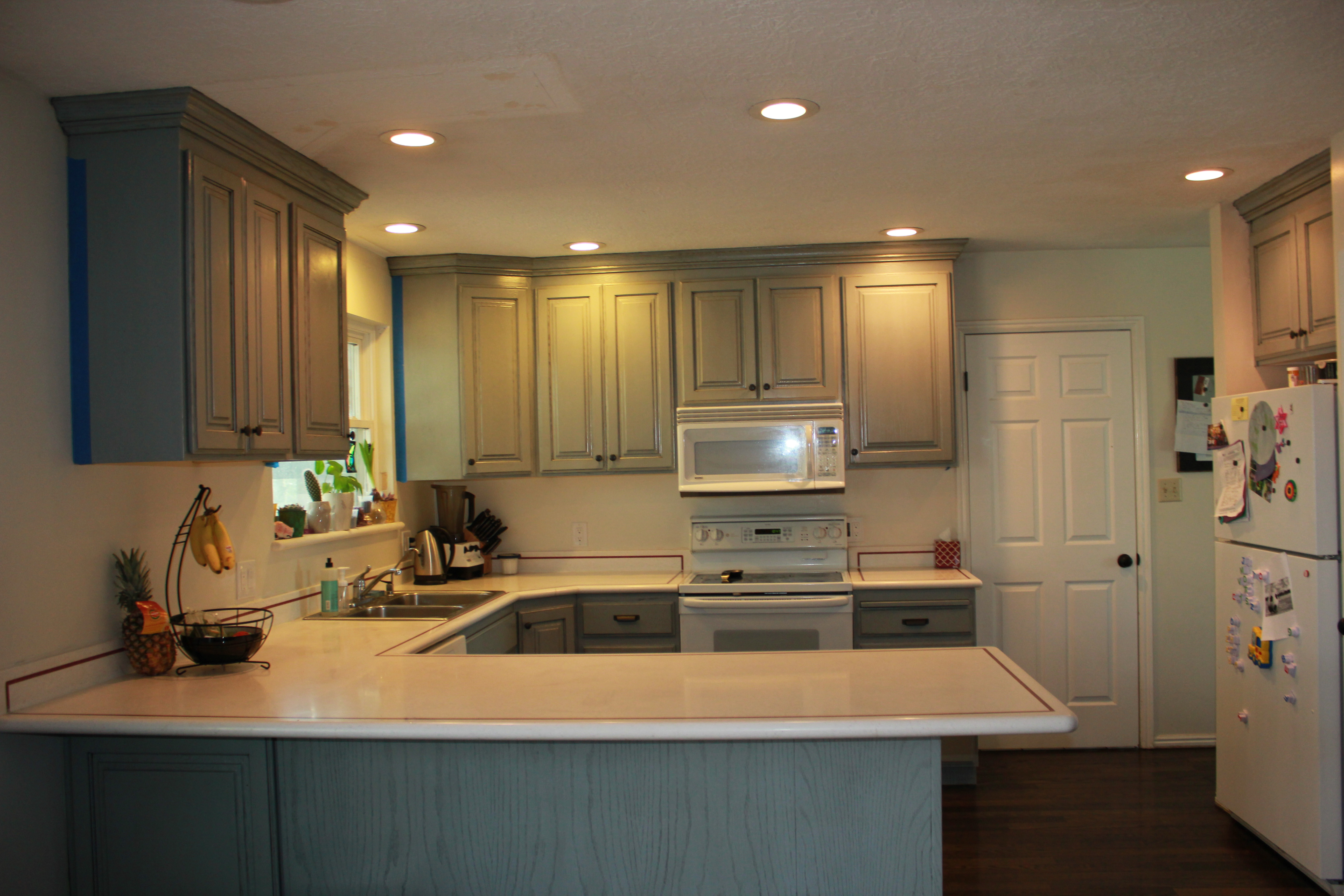 refinishing kitchen cabinets adding value to home